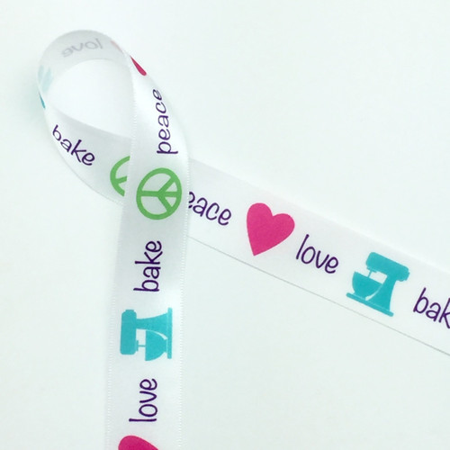 """Peace, Love, Bake in purple lettering with a lime peace symbol, pink heart and teal mixer on 7/8"""" White single face satin ribbon, 10 yards"""