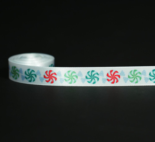 "Christmas Candy in red and green on 5/8"" white single face satin ribbon."