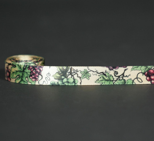 """Grapes in purple with green leaves on 5/8"""" raw silk single face satin ribbon offered on a raw silk tan ribbon."""