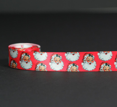Our vintage Santa with his rosy cheeks, big smile and fluffy beard will take you back to an old fashioned Christmas. Make your gifts extra special with this fun ribbon! Designed and printed in the USA