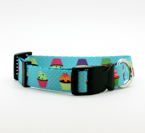 "Our 1"" wide cupcake dog collar is just the sweetest little addition to your pet's wardrobe! These fun cupcakes are decorated with colorful frostings and sprinkles on a turquoise polkadot background! Designed and printed in the USA"