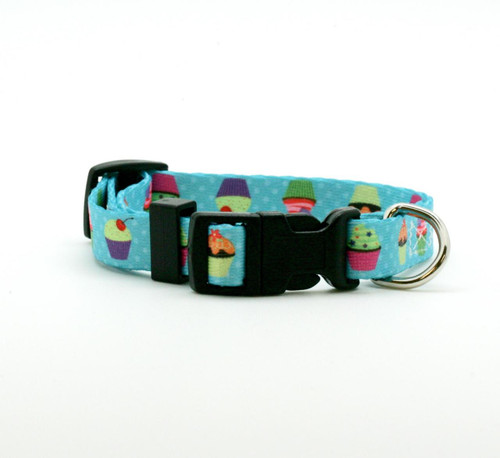 "Our 5/8"" wide cupcake dog collar is just the sweetest little addition to your pet's wardrobe! These fun cupcakes are decorated with colorful frostings and sprinkles on a turquoise polkadot background! Designed, printed and assembled in the USA"