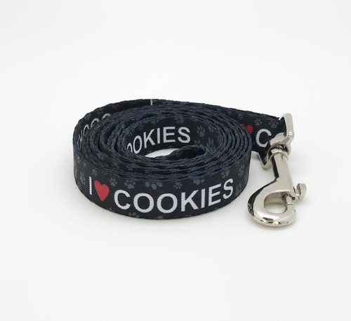 "Our I (heart) Cookies leash with paw prints in white on 5/8"" wide webbing is the perfect expression of your pet's opinion of his favorite treats! Designed printed and assembled in the USA"