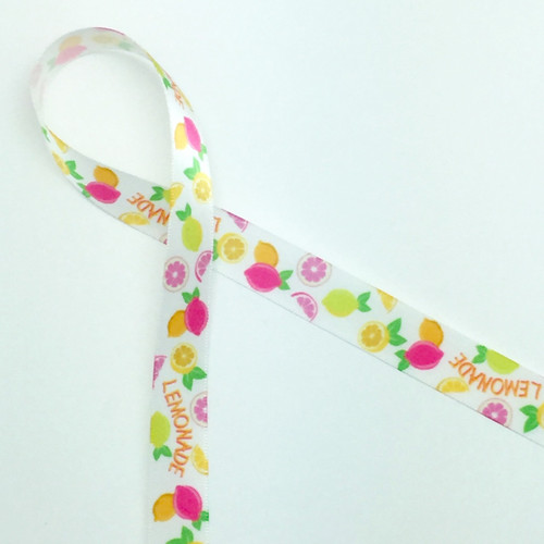 Lemons in yellow and pink with the word Lemonade  are featured on this fun Summer themed ribbon. This is the perfect accent for a gift or favor at any Summertime celebration!