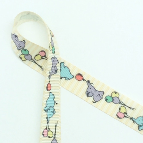 "Sweet baby elephants float along this 5/8"" antique white grosgrain ribbon aided by balloon bouquets. Designed and printed in the USA"