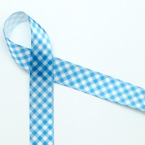 "Light Blue gingham printed on 5/8"" white single face satin ribbon is such a versatile ribbon for adorning gifts and favors. This is the go to ribbon for baby showers, christenings, birthdays and Summer parties."