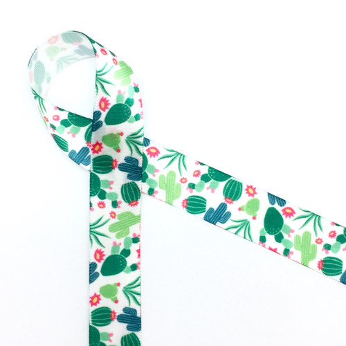 "Our cactus design on 5/8"" white single face satin features cacti and cactus flowers tossed on a white background. Make your next Southwest themed party extra fun by tying favors with our cactus ribbon!"