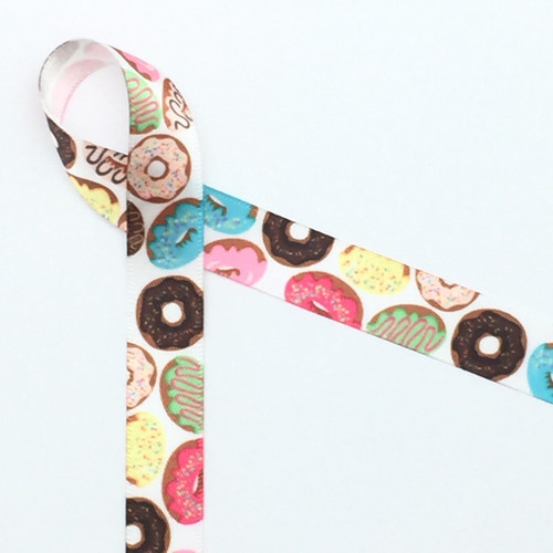 "Donuts printed in pastel colored frostings are tossed along our 5/8"" white single face satin!"