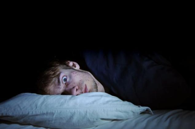 man awake at night unable to sleep