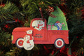 Truck Taking Home the Tree Family of 2