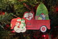 Truck Taking Home the Tree Family of 3