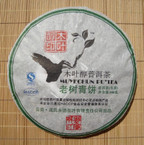 2008 Mengku Mu Ye Chun &quot;Old Tree Green Cake&quot; Raw Pu-erh - 400 grams