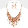 Gorgeous peach necklace and earring set. 542.