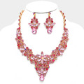 Delightfully pink necklace set with a flowery motif.
