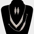 Enticing 3 piece necklace set with white stones and silver backing.