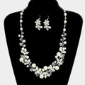 Pearls with white crystals in necklace set.