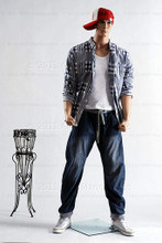 In this full body view photo, wearing a red cap, blue jeans, tennis shoes, and an open plain shirt showing a white t-shirt, mannequin Ken, stands with his legs even with his arms straight at his sides - hands in fists.  Mannequin Ken can be displayed with or without a wig / hairpiece.  Glass stand and support hardware included.