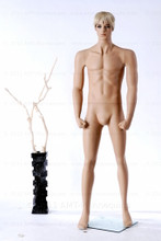 In this full body side view photo, wearing a short blond wig / hairpiece, mannequin Mike, stands with his left light slighly forward with his arms straight at his sides - hands in fists.  Mannequin Mike can be displayed with or without a wig / hairpiece.  Glass stand and support hardware included.