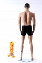 In this full body rear view photo, wearing a black swim suit, mannequin Mike, stands with his left light slighly forward with his arms straight at his sides - hands in fists.  Mannequin Mike can be displayed with or without a wig / hairpiece.  Glass stand and support hardware included.