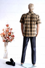 In this full body rear view photo, wearing a a short blond wig / hairpiece, plaid shirt with blue jeans, mannequin Mike, stands with his left light slighly forward with his arms straight at his sides - hands in fists.  Mannequin Mike can be displayed with or without a wig / hairpiece.  Glass stand and support hardware included.