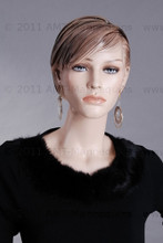 In this upper body close-up, mannequin Betty  displays a comfortable black knit top with long earrings. With pierced ears, mannequin Nancy can display earrings and jewelry.  Glass stand and support hardware included.