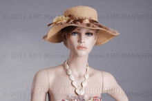 In this upper body close-up, mannequin Betty  displays a flowered sun dress with a festive straw hat. With pierced ears, mannequin Nancy can display earrings and jewelry.  Glass stand and support hardware included.
