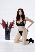 In this full body view, wearing a shoulder length dark brunette wig black bra and matching thong panties with high-heeled booties, mannequin Julie kneels with her hands almost touching her rear hips and both legs behind her.  With pierced ears, mannequin Julie can display earrings and jewelry.