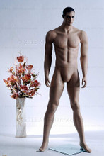 In this full body view photo, mannequin Matt stands with his legs apart in an even stance, with both hands almost straight down at hip level.  Mannequin Matt can be displayed with or without a wig / hairpiece.  Glass stand and support hardware included.