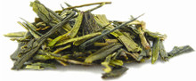 Also known as Lung-Ching, one of the most famous China green teas. Hand processing and pan-frying creates the signature flat shape. Its exquisite chestnutty flavor and delicate aroma are perfect any time of the day as a picker-upper and makes a great iced tea. Low in caffeine.