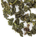 Oolong tea from Taiwan. Formosa, meaning 'beautiful' was what the Dutch explorers called this island. The oolong teas grown here continue to be called as such. Unlike its dark brethren, this is a Jade Oolong tea, almost green in appearance with large, hand-rolled leaves. Once infused, these unfurl to release this tea's delicate notes, exquisite flavor and enchanting fragrance. Our 'Oolong Symphony no. 18' tea is sure to become your favorite. We urge you to give it a try.   Steep at 180° for 3-5 minutes