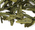Fresh and crisp green tea from China with the energizing flavor of ginseng, accented with dried ginger. Sweet, earthy green aroma, notes of fresh hay and delicately spicy herbs. Pleasantly bittersweet without being medicinal. Soothing, soft finish. A very grounding cup of tea.
