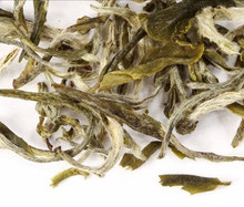 Green tea from the Fujian province of China. Green Pekoe is famed as an everyday tea, and is among the most popular teas consumed in China. Its thin, wavy leaves appear almost black when dry. Once infused, however, our 'Green Pekoe Blues' reveals its true color. And produces a light cup with a smooth, mellow taste and a gentle, soothing aroma.