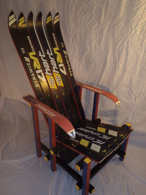 The Sierra Chair. This piece uses vintage 60's skis. The wooden bottom and sides, are hand stained with lively colors, accenting the ski graphics.