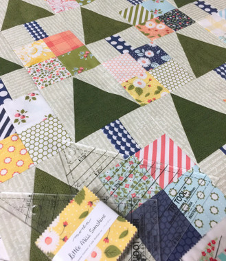 Templates are included in the pattern but the EZ Quilting Tr-Rec tool makes cutting and sewing the triangles in a square a breeze.
