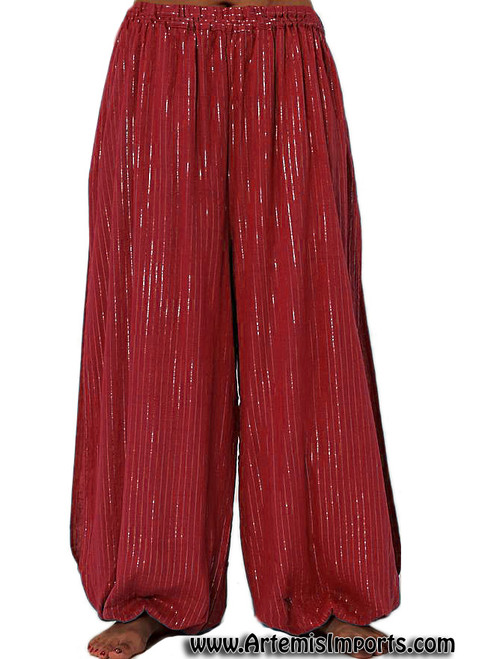Super cute harem pants made of cotton with lurex lines running through the fabric and a slit down both legs at side in red.
