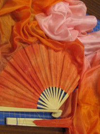 ORDERABLE: Med stave, STANDARD 60inch Long Pair of Fans in ZAHARA DAWN  with TANGERINE HAND