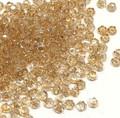 2mm Swarovski Rounds, Crystal Golden Shadows (Qty: 50)