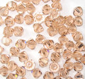 4mm Swarovski bicones - Light Peach (50)