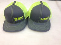 Neon yellow trucker mesh caps with left front embroidery