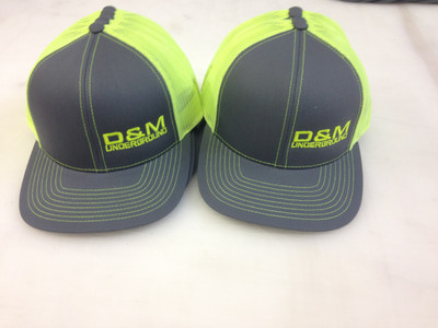 Neon yellow trucker mesh caps with left front embroidery D and M
