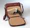 Full zippered concealed carry compartment keeps your weapon available close to your body