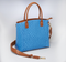 Beautiful blue concealed carry handbag makes a high fashion statement