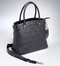 Can be carried with a short handle or with the over-the-shoulder strap