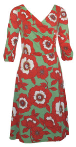 Bright orange and jade green poppy field sleeved wrap dress