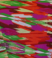 Red pink yellow ethnic feather print cotton blend fabric swatch