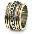 Wide Band with Multi Revolving Rings and Central Infinity Band