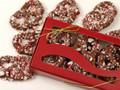 A festive red box with six milk chocolate peppermint pretzels. A treat for all the senses - sweet, salty, crunchy