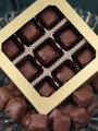 Gift box containing nine pieces of plain milk chocolate butter toffee.