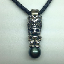 Shown with 13mm Tahitian pearl, on black leather cord,