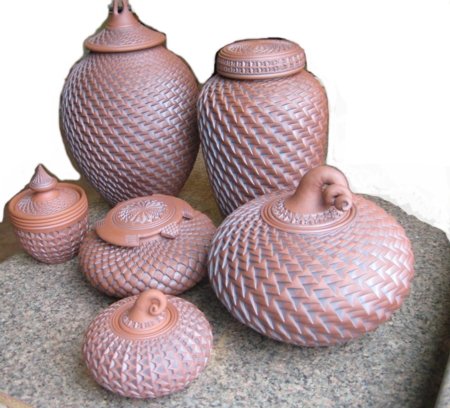 Intricate urn vessels from Ken Standhardt